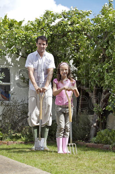 man and girl with gardening tools stock photo