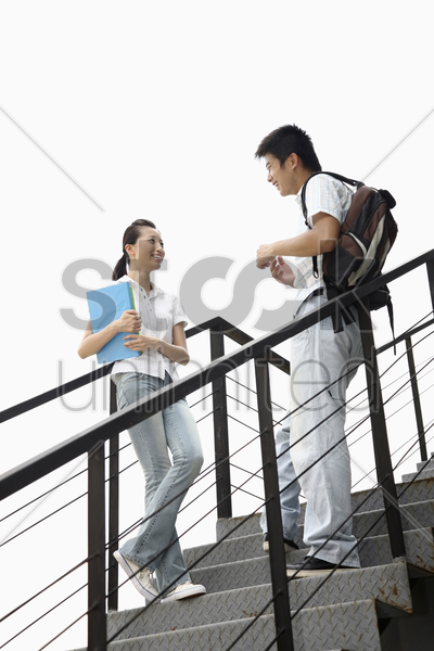 man and woman chatting stock photo
