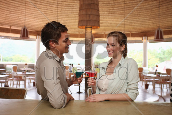 man and woman drinking at the bar stock photo
