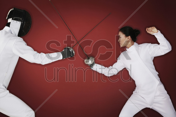 man and woman dueling stock photo