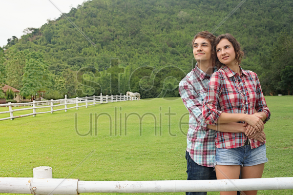 man and woman embracing outdoor stock photo