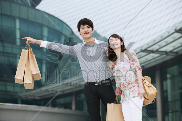 man and woman hailing a cab stock photo