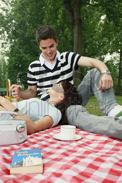 man and woman having a picnic stock photo