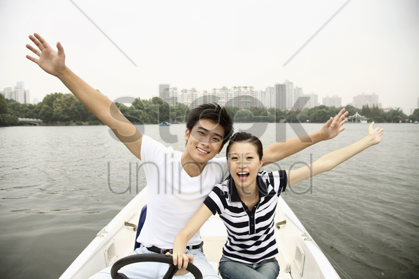 man and woman having fun traveling on the boat stock photo