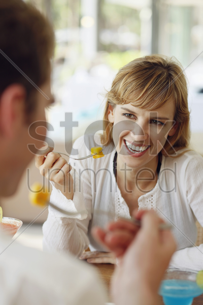 man and woman having lunch at restaurant stock photo