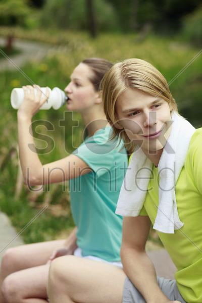man and woman in sports clothing stock photo