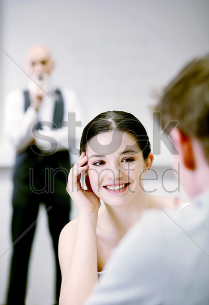 man and woman looking at each other in the classroom stock photo