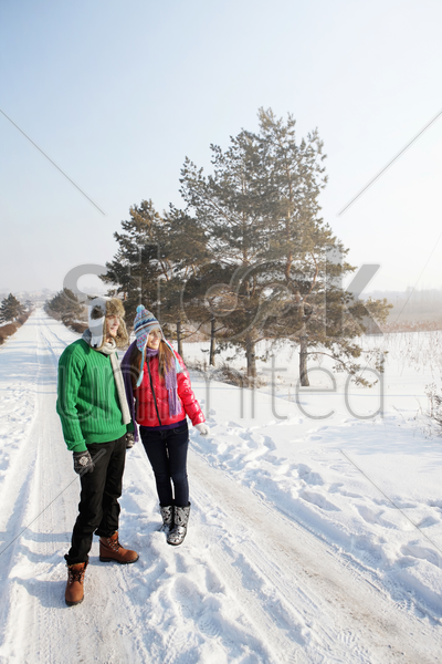 man and woman on winter day stock photo