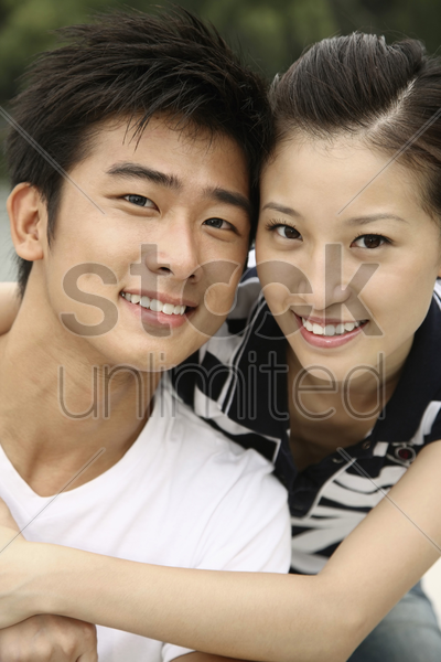 man and woman posing on the boat stock photo
