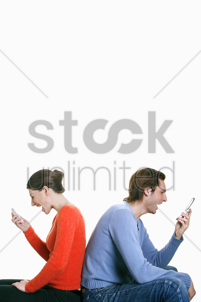man and woman screaming into their cell phones stock photo