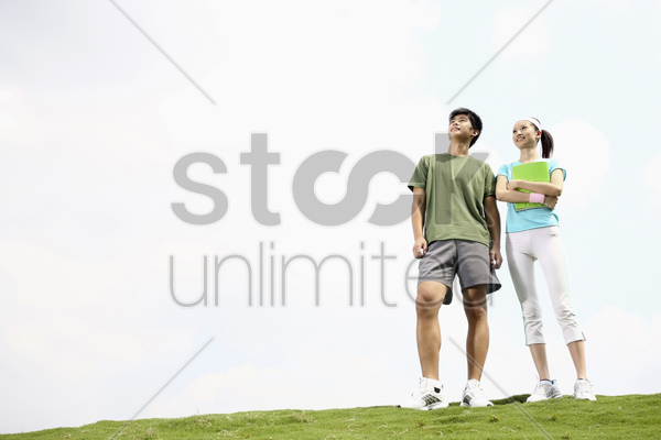 man and woman smiling while looking away stock photo