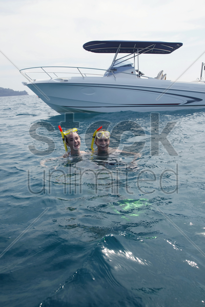 man and woman snorkeling in the ocean stock photo