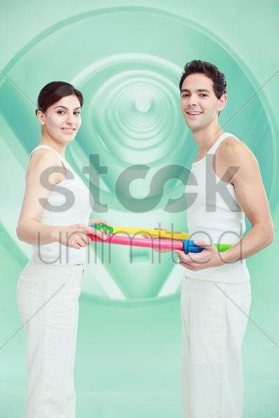 man and woman standing in a plastic hoop stock photo