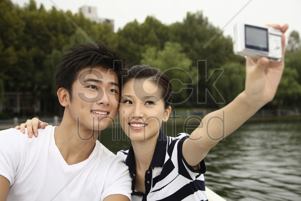 man and woman taking picture together while traveling on the boat stock photo