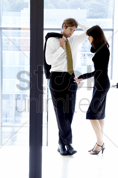 man and woman talking stock photo