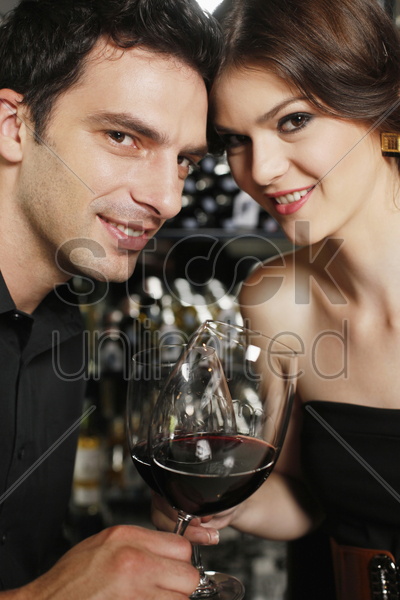 man and woman toasting stock photo