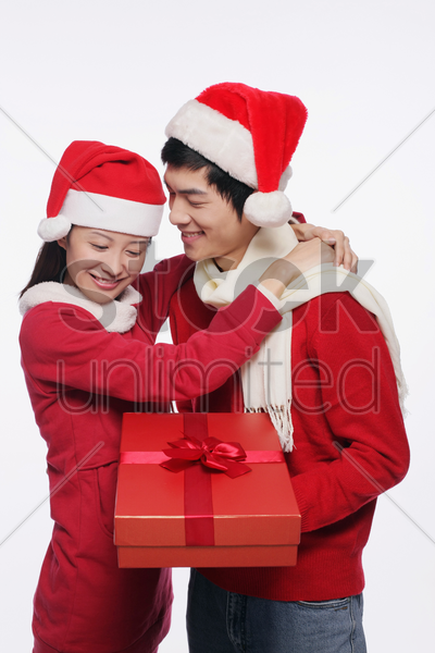 man and woman with a gift stock photo
