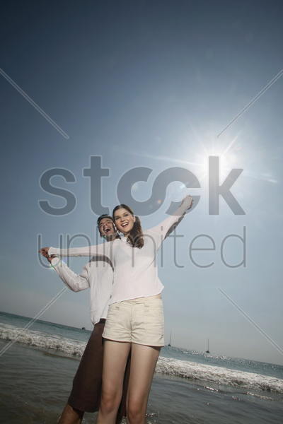 man and woman with arms stretched out stock photo