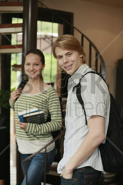 man and woman with backpacks stock photo