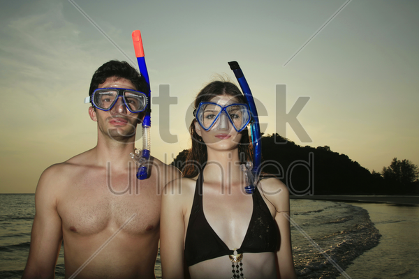 man and woman with scuba mask stock photo