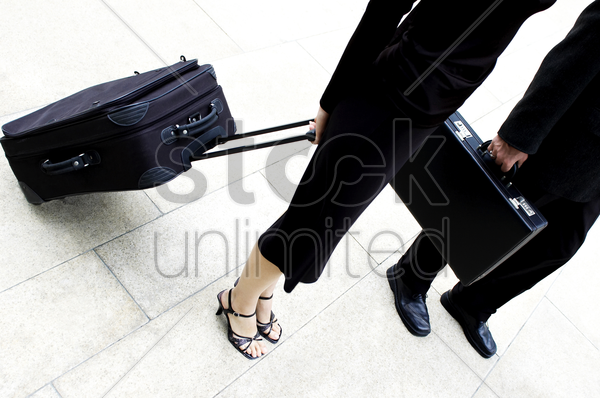 man and woman with their bags stock photo