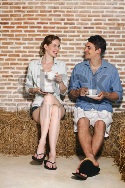 man and woman with their cups of coffee stock photo