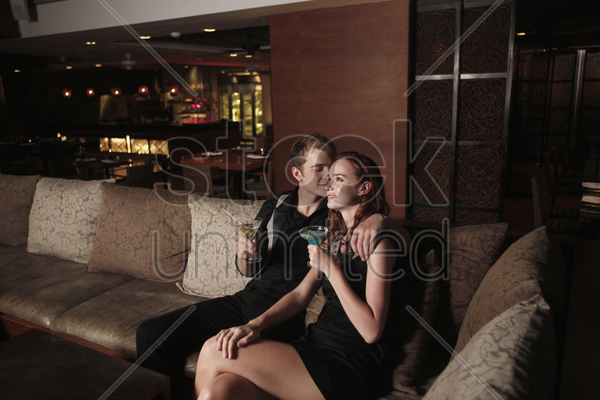 man and woman with their drinks stock photo