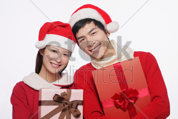 man and woman with their gifts stock photo