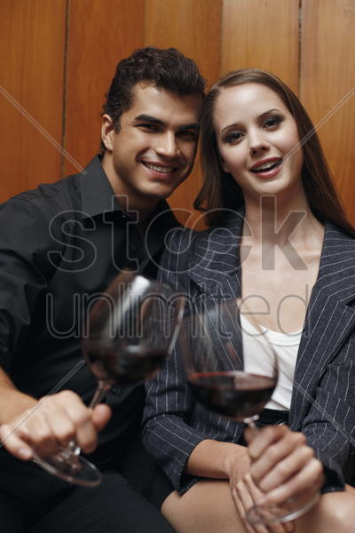man and woman with their glasses of wine stock photo