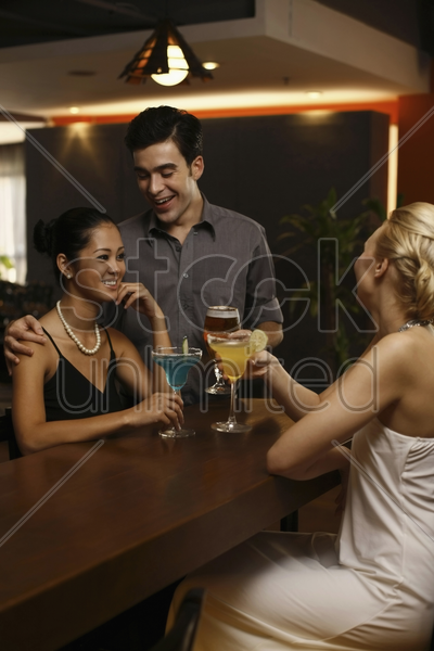 man and women drinking at a bar stock photo
