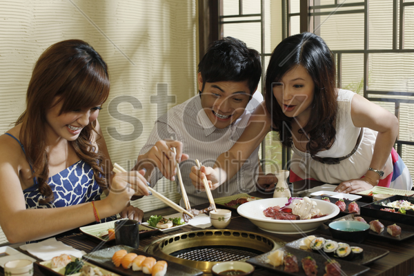 man and women fighting over a piece of meat stock photo