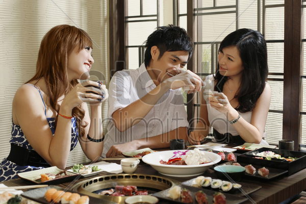 man and women having fun in a restaurant stock photo