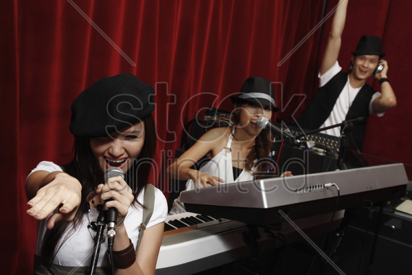 man and women jamming in studio stock photo