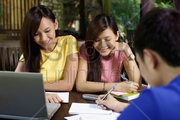 man and women studying together stock photo