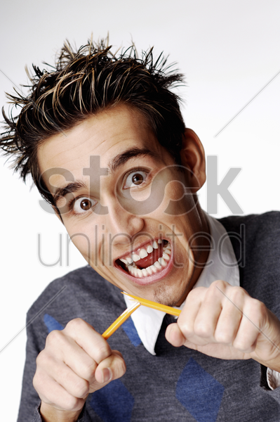 man breaking a pencil stock photo