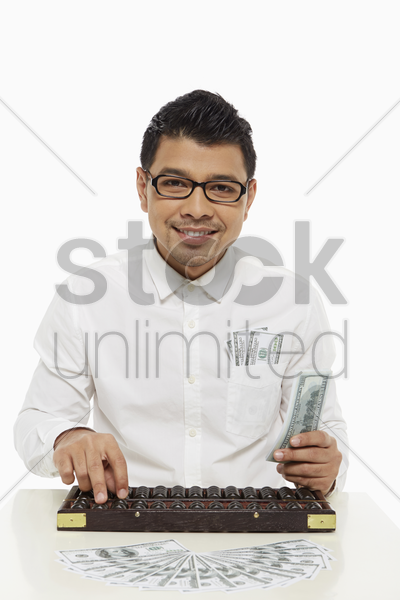 man calculating using an abacus stock photo
