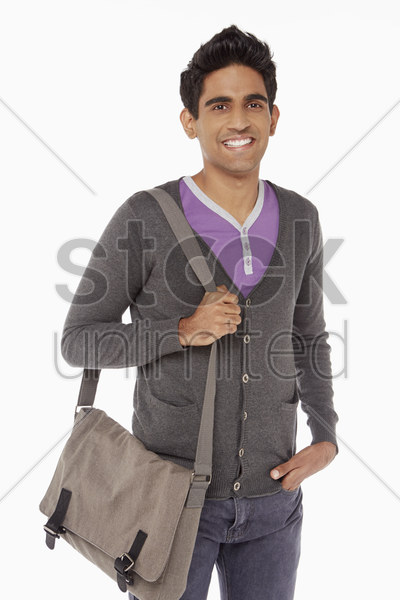 man carrying a sling bag stock photo