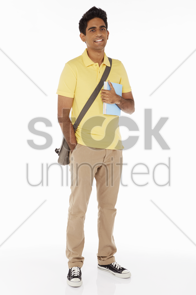 man carrying books, smiling stock photo
