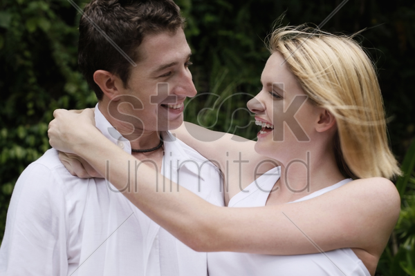 man carrying woman in his arms stock photo