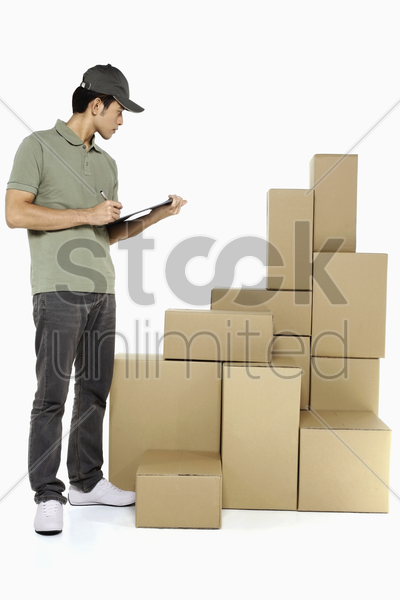 man checking packages stock photo