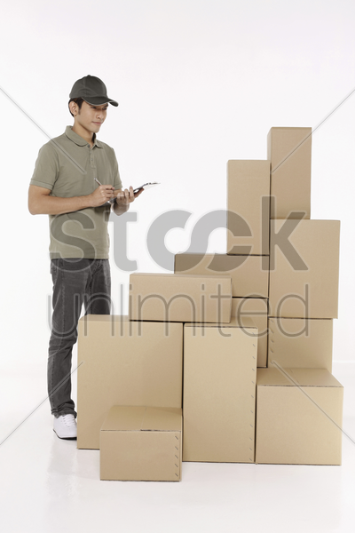 man checking the packages stock photo