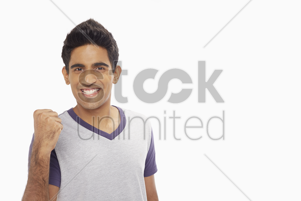 man cheering and pumping his fist stock photo