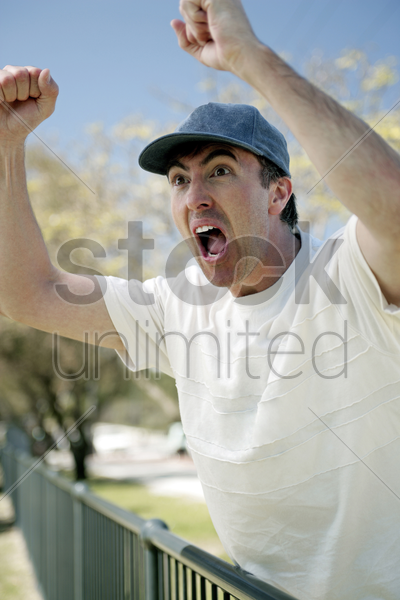 man cheering out loud stock photo
