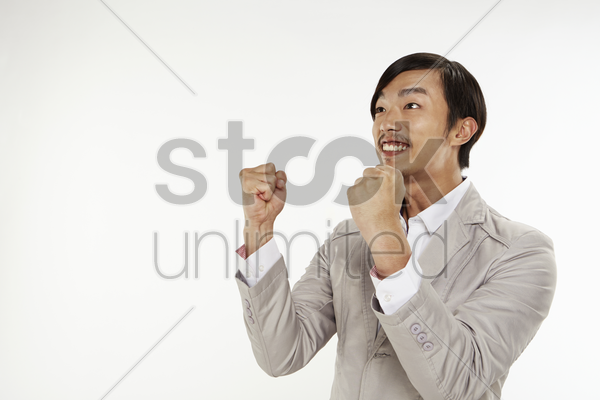man cheering with fists help up stock photo