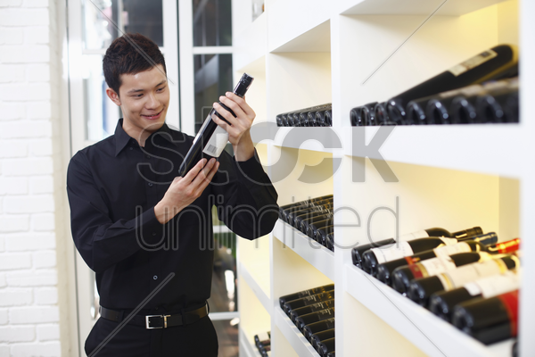 man choosing wine stock photo