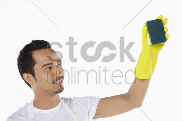 man cleaning with sponge stock photo