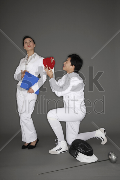 man courting a businesswoman stock photo