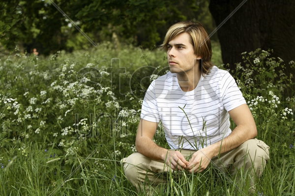 man daydreaming in the park stock photo