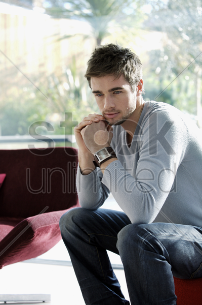 man daydreaming stock photo
