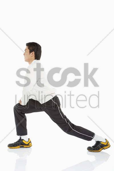 man doing lunges, facing left stock photo
